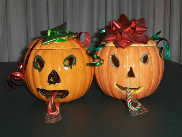 Two pumpkins with Christmas trim