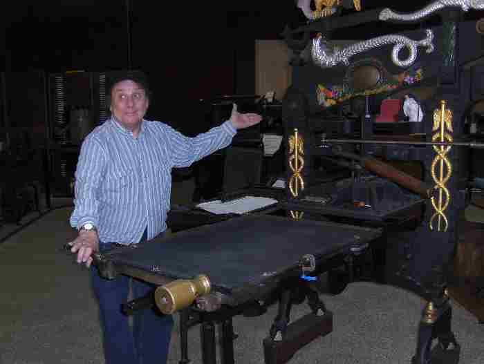 Phil Soinski with antique press