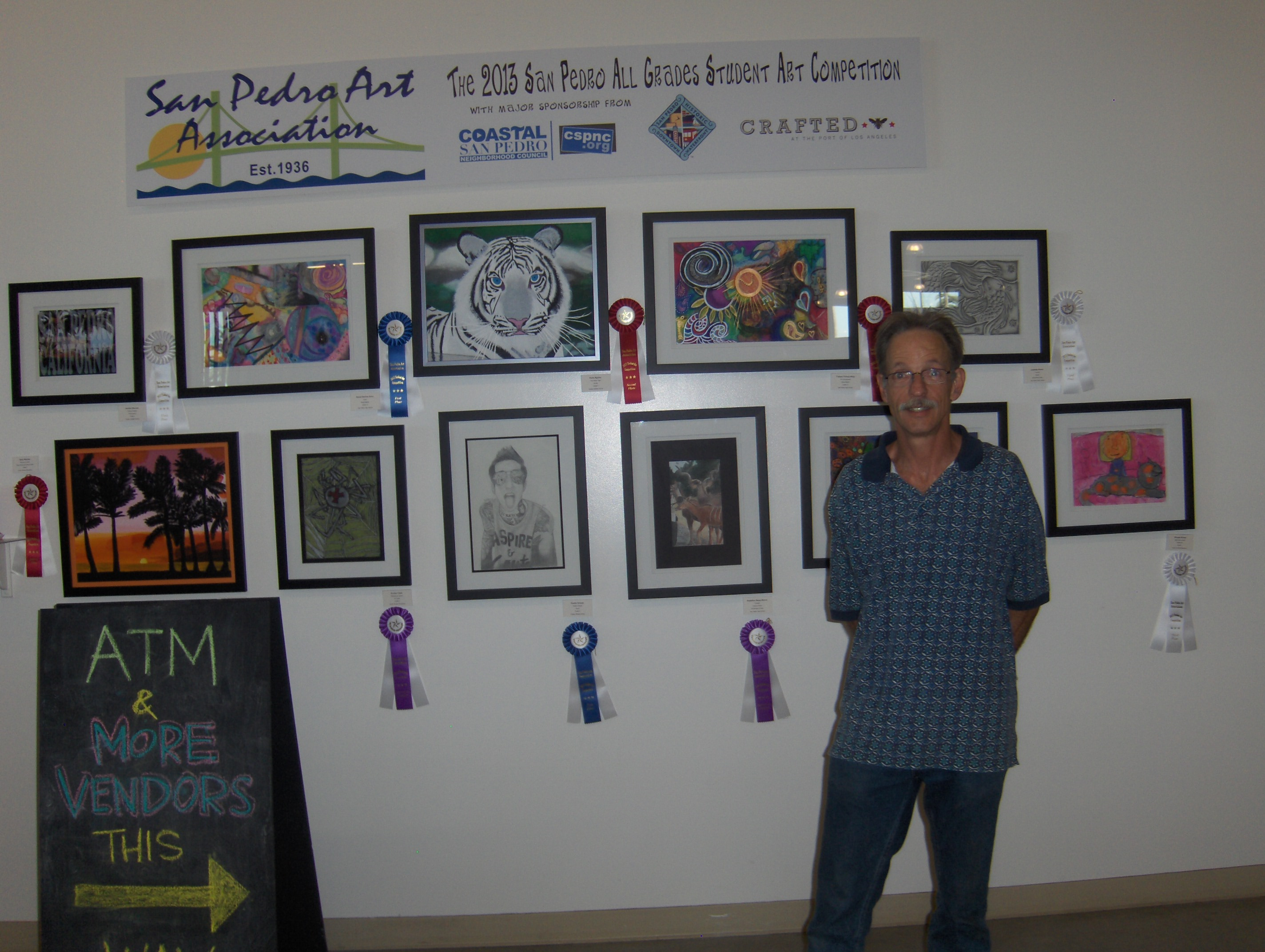 Steve Magee with art for SPAA Student Competition