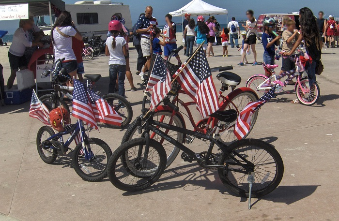 bike decorated with Amarican flags waits as children compete in patriotic speech contest