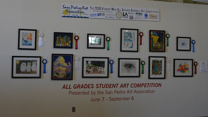 All-Grades Student Art Competition entries on wall