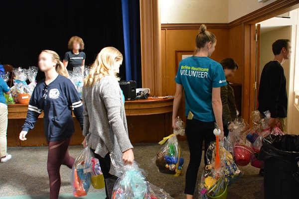 volunteers take baskets to waiting truck