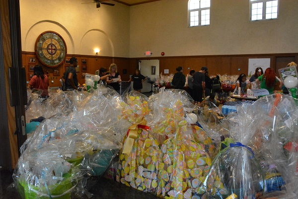 Easter baskets in foreground as volunteers work