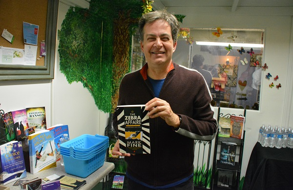 Author Mark Fine with his book The Zebra Affaire