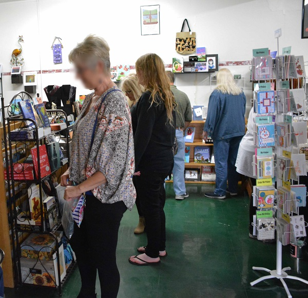 shoppers inside Pipe and Thimble Bookstore