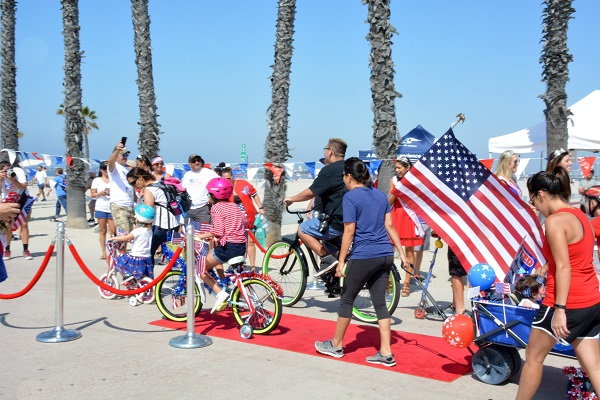 Long Beach 4th of July Bike Parad with flag