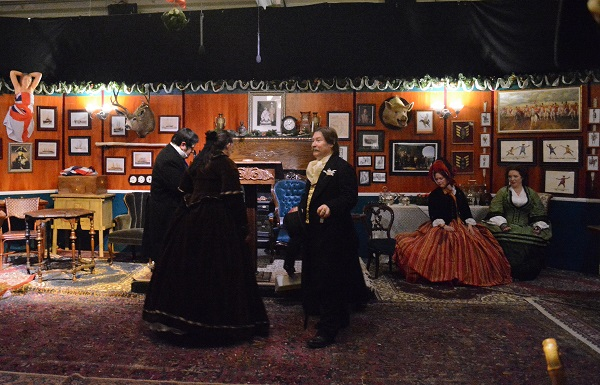 Men and women in Victorian costumes in the Adventurers Club