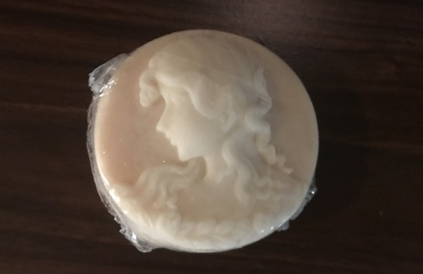 pink soap that looks like a cameo with a woman's head in white