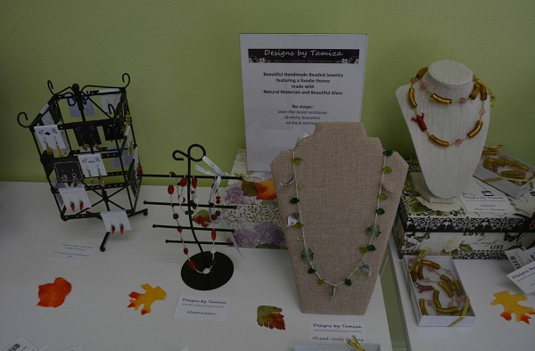 Handcradted necklaces on a display table
