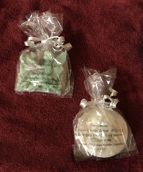 fairytale and carriage soaps on red plush background