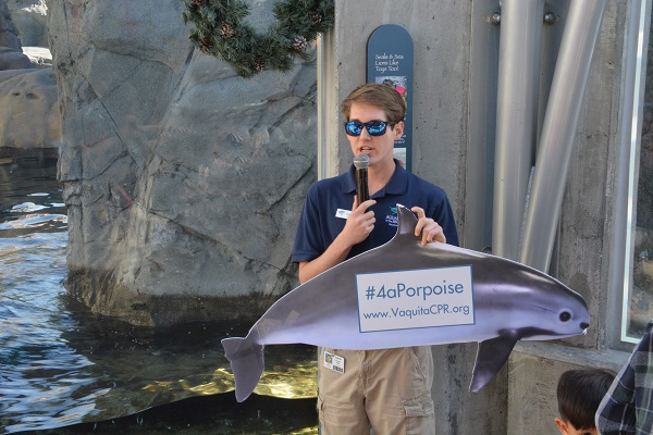 Volunteer Cameron with vaquita conservation socail-media sign
