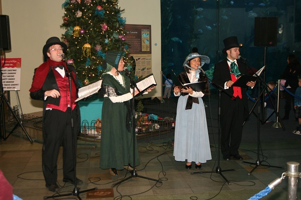 Christmas carolers singing at the Aquarium of the Pacific