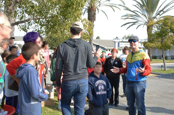 Justin Rudd addresses Operation Santa Paws group outside Long Beach Animal Care Services