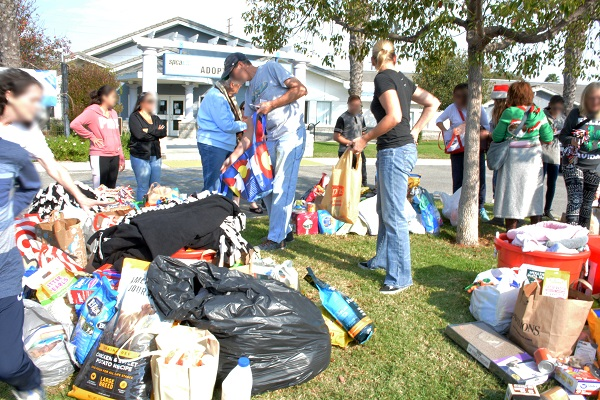 Volunteers set out pet food and supplies outside Long Beach Animal Care Services building