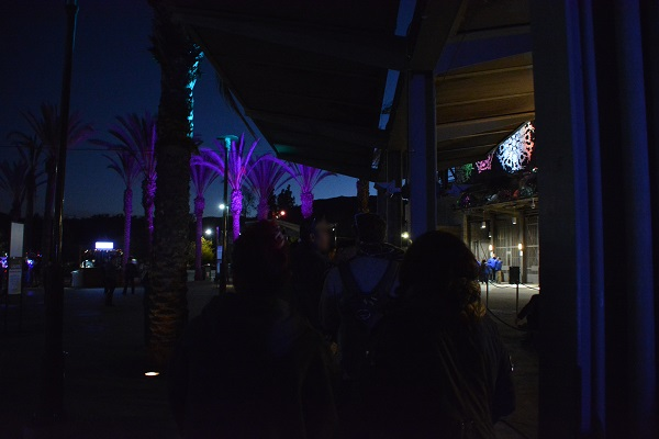 people wait in line outside Los Angeles Zoo gates at night