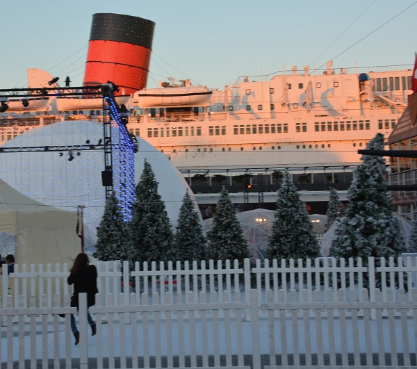 Woman swings on zip line near Queen Mary